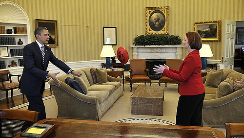 Julia Gillard and Barrack Obama trying Aussie Rules Game